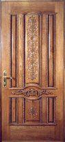 Металлическая дверь, обшитая древесиной